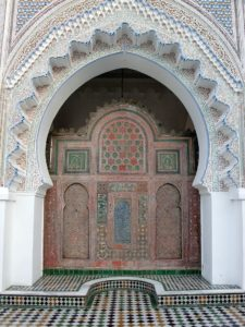 Ornately decorated doorway with mosaics