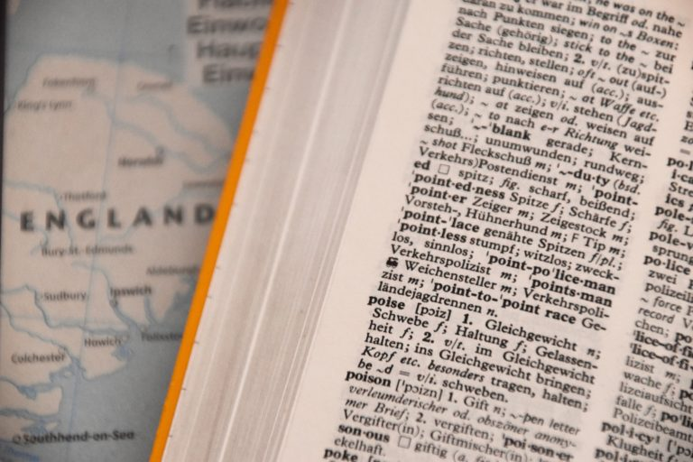 German language dictionary next to map of England